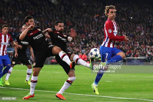 Antoine Griezmann of Club Atletico de Madrid competes with Kevin Volland of Bayer Leverkusen during the UEFA Champions League Round of 16 second leg...