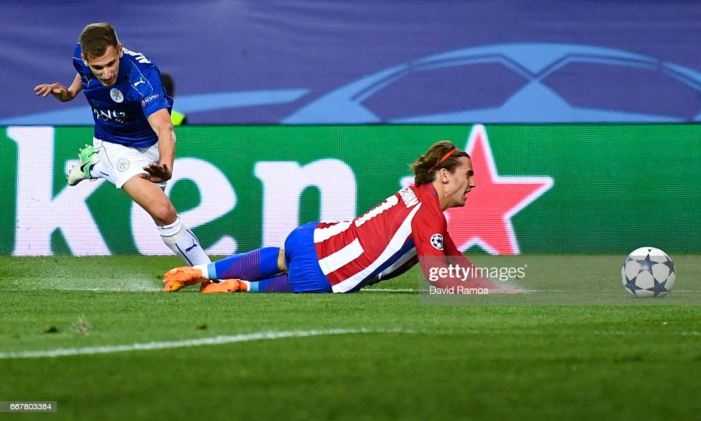 Antoine Griezmann of Club Atletico de Madrid is fouled in the penalty area by Marc Albrighton of Leicester City during the UEFA Champions League Quarter Final first leg match between Club Atletico de Madrid and Leicester City at Vicente Calderon Stadium on April 12, 2017 in Madrid, Spain.