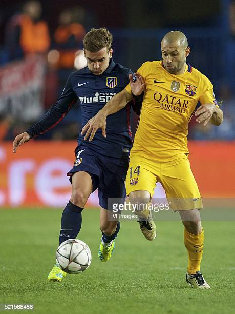 Antoine Griezmann of Club Atletico de Madrid Javier Mascherano of FC Barcelona during the UEFA Champions League quarterfinal match between Atletico...