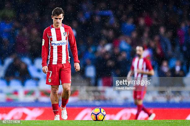 Antoine Griezmann of Club Atletico de Madrid reacts dejected after William Jose of Real Sociedad de Futbol scored his team's second goal during the...