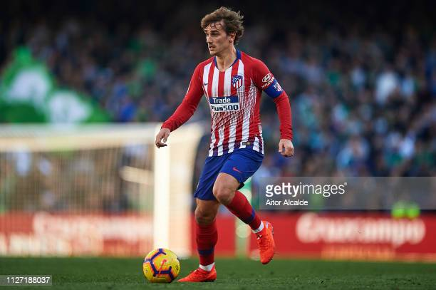 Antoine Griezmann of Club Atletico de Madrid runs with the ball during the La Liga match between Real Betis Balompie and Club Atletico de Madrid at...