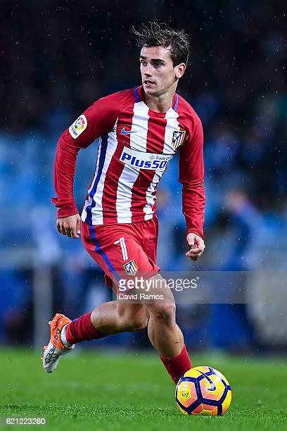 Antoine Griezmann of Club Atletico de Madrid runs with the ball during the La Liga match between Real Sociedad de Futbol and Atletico de Madrid at...