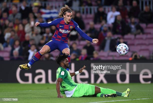 Antoine Griezmann of FC Barcelona and Chidozie Awaziem of CD Leganes fight for the ball during the Copa del Rey Round of 16 match between FC...