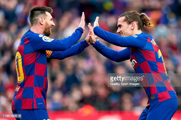 Antoine Griezmann of FC Barcelona and Lionel Messi celebrating their team's first goal during the Liga match between FC Barcelona and Deportivo...