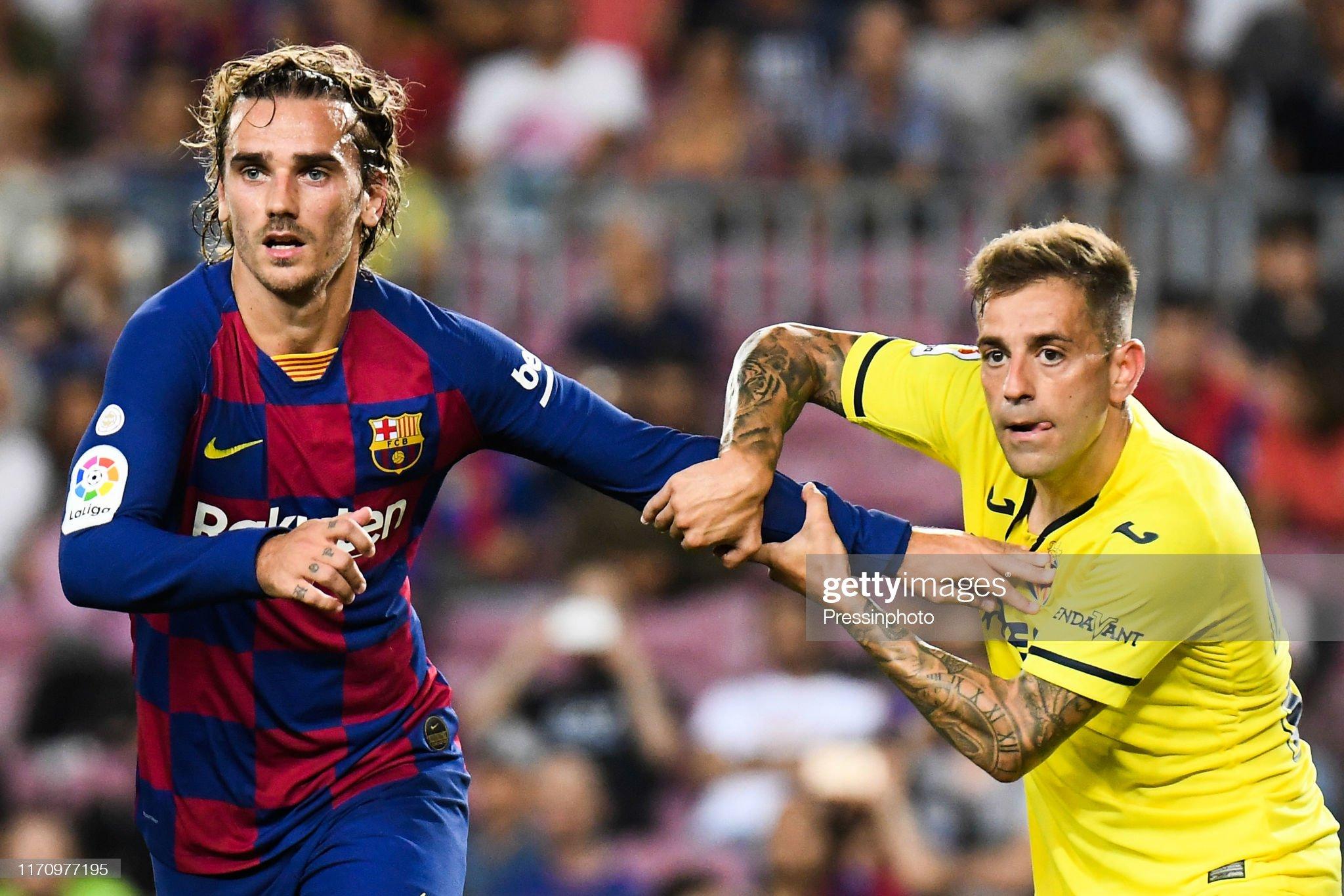 صور مباراة : برشلونة - فياريال 2-1 ( 24-09-2019 )  Antoine-griezmann-of-fc-barcelona-and-ruben-pena-of-villarreal-of-picture-id1170977195?s=2048x2048