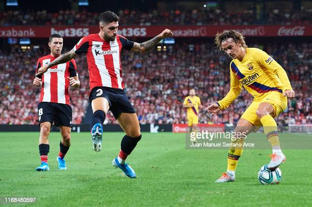 Antoine Griezmann of FC Barcelona being followed by Unai Nunez of Athletic Club during the Liga match between Athletic Club and FC Barcelona at San...