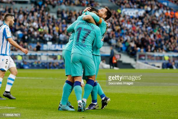 Antoine Griezmann of FC Barcelona celebrates 11 with Lionel Messi of FC Barcelona during the La Liga Santander match between Real Sociedad v FC...