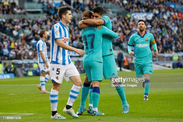 Antoine Griezmann of FC Barcelona celebrates 11 with Luis Suarez of FC Barcelona during the La Liga Santander match between Real Sociedad v FC...