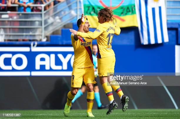 Antoine Griezmann of FC Barcelona celebrates after scoring goal with Luis Suarez of FC Barcelona during the Liga match between SD Eibar SAD and FC...