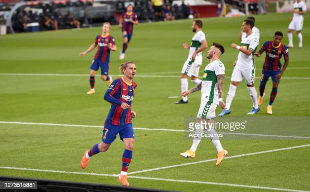 Antoine Griezmann of FC Barcelona celebrates after scoring his team's first goal during the Joan Gamper Trophy match between FC Barcelona and Elche...