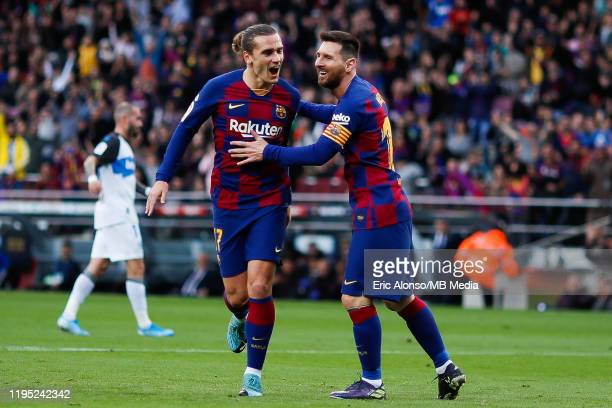 Antoine Griezmann of FC Barcelona celebrates after scoring the 10 with teammate Lionel Messi during the Liga match between FC Barcelona and Deportivo...