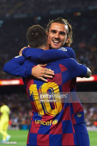 Antoine Griezmann of FC Barcelona celebrates with his teammate Lionel Messi after scoring the opening goal during the Liga match between FC Barcelona...