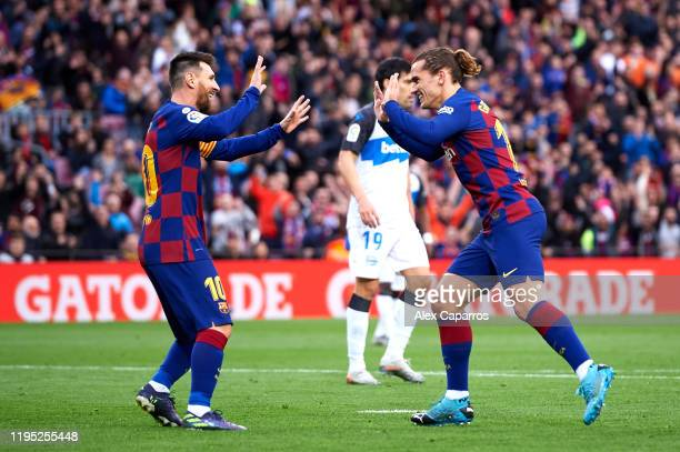 Antoine Griezmann of FC Barcelona celebrates with his teammate Lionel Messi after scoring the opening goal during the La Liga match between FC...