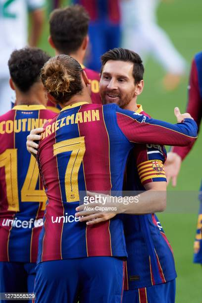 Antoine Griezmann of FC Barcelona celebrates with his teammate Lionel Messi after scoring the opening goal during the Joan Gamper Trophy match...