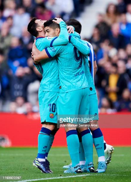 Antoine Griezmann of FC Barcelona celebrates with his teammate Luis Suarez anc Lionel Messi of FC Barcelona after scoring the opening goal during the...