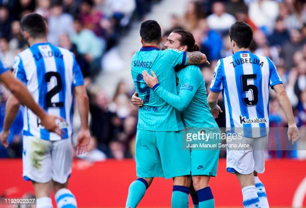Antoine Griezmann of FC Barcelona celebrates with his teammate Luis Suarez of FC Barcelona after scoring the opening goal during the Liga match...