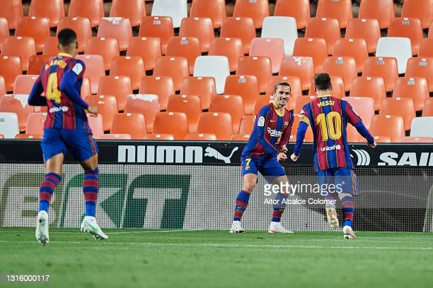 Antoine Griezmann of FC Barcelona celebrates with team mate Lionel Messi after scoring their side's second goal during the La Liga Santander match...