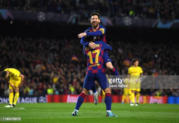 Antoine Griezmann of FC Barcelona celebrates with teammate Lionel Messi after scoring his team's third goal during the UEFA Champions League group F...