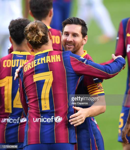 Antoine Griezmann of FC Barcelona celebrates with teammate Lionel Messi after scoring his team's first goal during the Joan Gamper Trophy match...