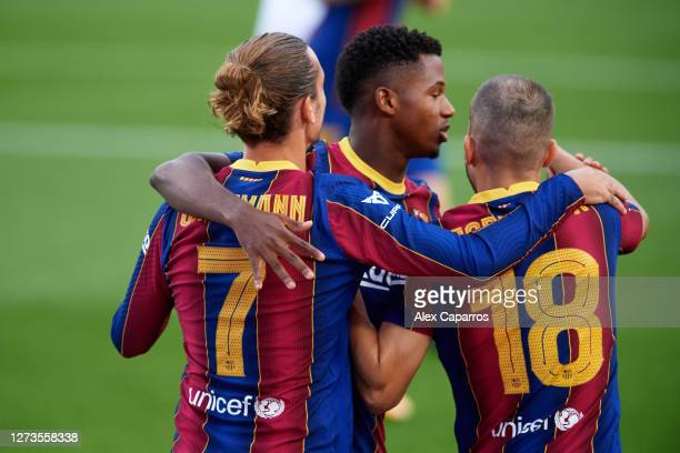 Antoine Griezmann of FC Barcelona celebrates with teammates after scoring the opening goal during the Joan Gamper Trophy match between FC Barcelona...