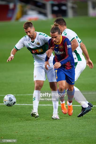 Antoine Griezmann of FC Barcelona clashes with Elche CF players during the Joan Gamper Trophy match between FC Barcelona and Elche CF on September 19...