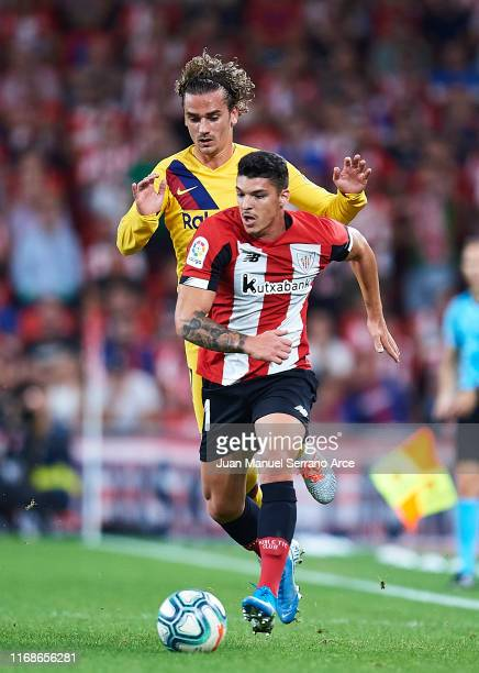 Antoine Griezmann of FC Barcelona competes for the ball with Ander Capa of Athletic Club during the Liga match between Athletic Club and FC Barcelona...