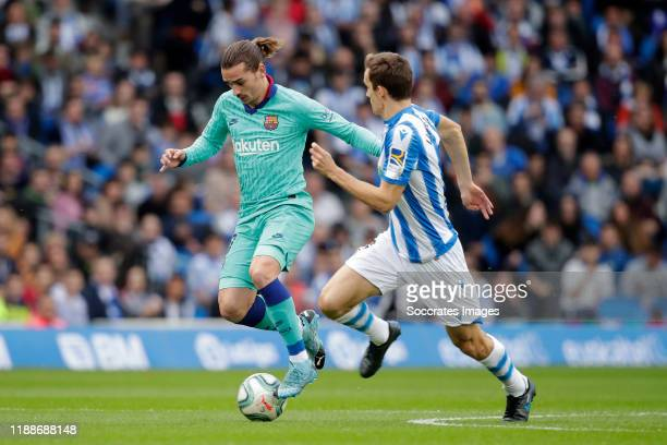 Antoine Griezmann of FC Barcelona Diego Llorente of Real Sociedad during the La Liga Santander match between Real Sociedad v FC Barcelona at the...