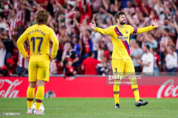 Antoine Griezmann of FC Barcelona, Gerard Pique of FC Barcelona during the La Liga Santander match between Athletic de Bilbao v FC Barcelona at the...