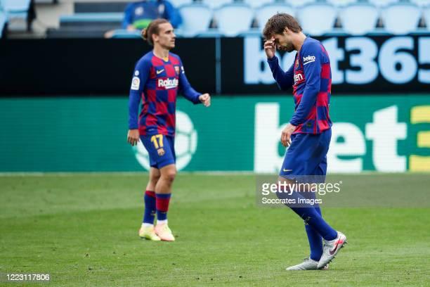 Antoine Griezmann of FC Barcelona Gerard Pique of FC Barcelona during the La Liga Santander match between Celta de Vigo v FC Barcelona at the Estadio...