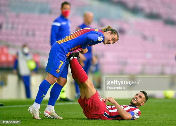 Antoine Griezmann of FC Barcelona helps Koke Resurreccion of Atletico de Madrid during the La Liga match between FC Barcelona and Atletico de Madrid...
