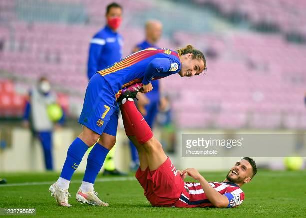 Antoine Griezmann of FC Barcelona helps Koke Resurreccion of Atletico de Madrid during the La Liga match between FC Barcelona and Atletico de Madrid...