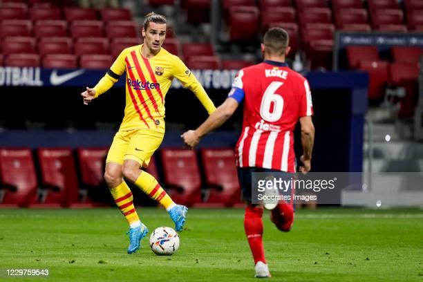 Antoine Griezmann of FC Barcelona Koke of Atletico Madrid during the La Liga Santander match between Atletico Madrid v FC Barcelona at the Estadio...