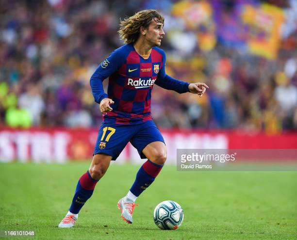 Antoine Griezmann of FC Barcelona runs with the ball during the Joan Gamper trophy friendly match between FC Barcelona and Arsenal at Nou Camp on...