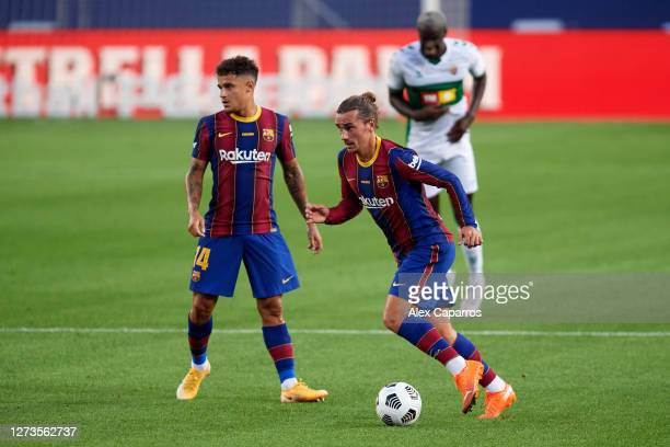 Antoine Griezmann of FC Barcelona runs with the ball next to Philippe Coutinho during the Joan Gamper Trophy match between FC Barcelona and Elche CF...