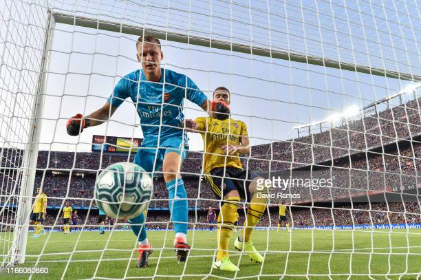 Antoine Griezmann of FC Barcelona scores a disallowed goal past Bernd Leno and Calum Chambers of Arsenal during the Joan Gamper trophy friendly match...