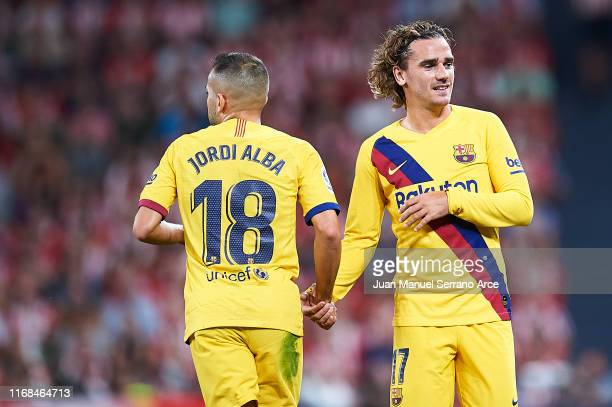 Antoine Griezmann of FC Barcelona shake hands with Jordi Alba of FC Barcelona during the Liga match between Athletic Club and FC Barcelona at San...