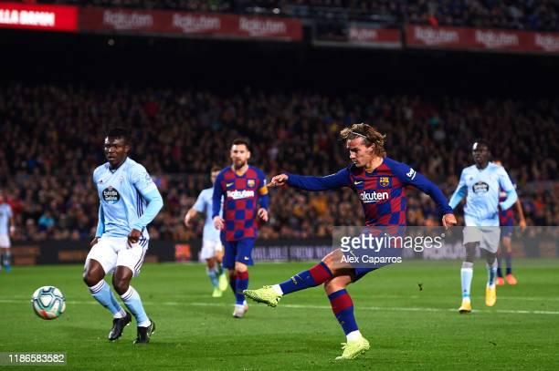 Antoine Griezmann of FC Barcelona shoots the ball during the La Liga match between FC Barcelona and RC Celta de Vigo at Camp Nou stadium on November...