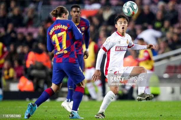 Antoine Griezmann of FC Barcelona, Takefusa Kubo of Real Mallorca during the La Liga Santander match between FC Barcelona v Real Mallorca at the Camp...