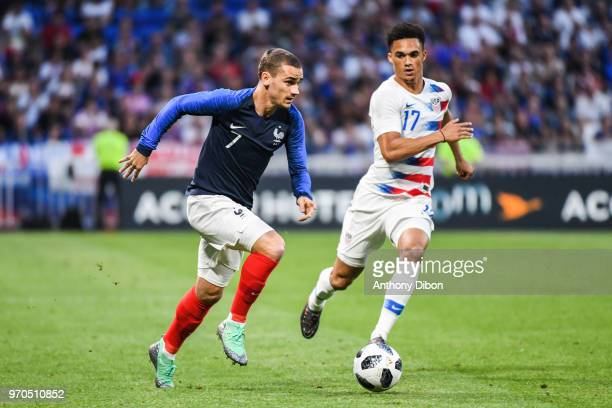 Antoine Griezmann of France and Antonee Robinson of USA during the International Friendly match between France and United States at Groupama Stadium...