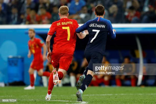 Antoine Griezmann of France and Kevin De Bruyne of Belgium in action during the 2018 FIFA World Cup Russia semi final match between France and...