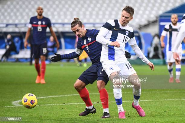 Antoine GRIEZMANN of France and Robert TAYLOR of Finland during the international friendly match between France and Finland at Stade de France on...