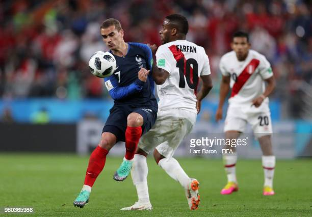 Antoine Griezmann of France battles for possession with Jefferson Farfan of Peru during the 2018 FIFA World Cup Russia group C match between France...