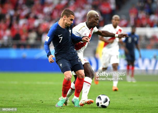 Antoine Griezmann of France battles for possession with Luis Advincula of Peru during the 2018 FIFA World Cup Russia group C match between France and...