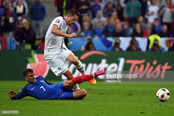 Antoine Griezmann of France battles with Gylfi Sigurdsson of Iceland during the UEFA EURO 2016 quarter final match between France and Iceland at...