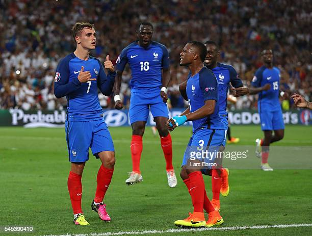 Antoine Griezmann of France celebrates after scoring the opening goal from the penalty spot during the UEFA EURO semi final match between Germany and...