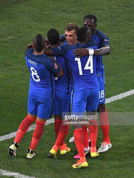 Antoine Griezmann of France celebrates after scoring the opening goal with his team mates during the UEFA EURO semi final match between Germany and...