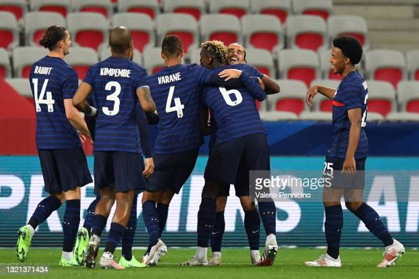 Antoine Griezmann of France celebrates after scoring their sides second goal with team mate Paul Pogba during the international friendly match...