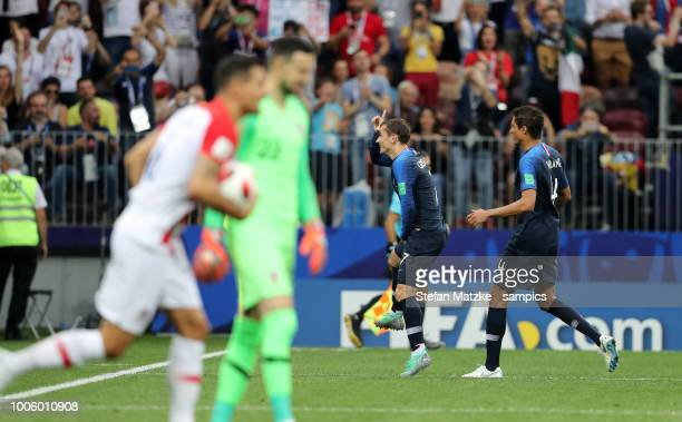 Antoine Griezmann of France celebrates as he scores the goal 21 Raphael Varane of France during the 2018 FIFA World Cup Russia Final between France...