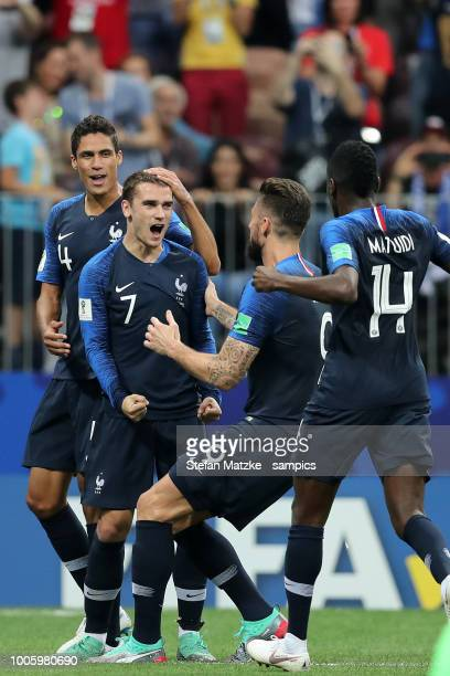 Antoine Griezmann of France celebrates as he scores the goal 21 with Raphael Varane of France Olivier Giroud of France during the 2018 FIFA World Cup...