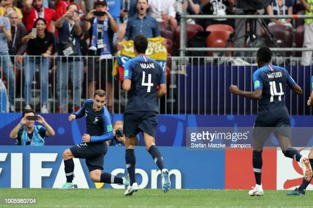 Antoine Griezmann of France celebrates as he scores the goal 21 with Raphael Varane of France during the 2018 FIFA World Cup Russia Final between...